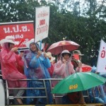 Braving the rain - Redshirts in party mood at the 19-9 rally (Photo - Simon Roughneen)