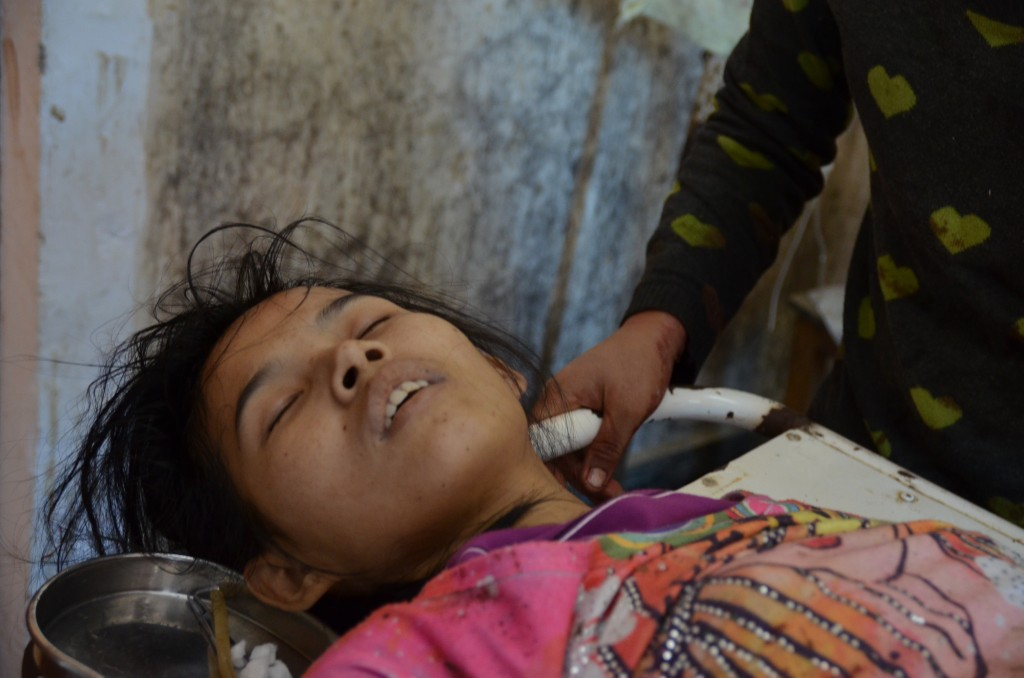 Severely-wounded Lamong Kailing receiving treatment at Laiza hospital this morning (Photo: Simon Roughneen)
