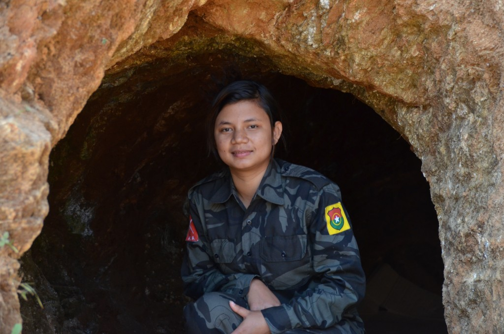 Seng Mai tries out bunker near her unit's checkpoint (Photo: Simon Roughneen)