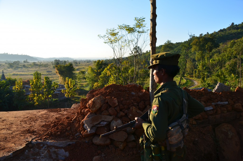 A soldier from the Kachin Independence Army (KIA) stands on lookout at a captured Burma Army position on the Laiza-Myitkyina road. (Photo: Simon Roughneen