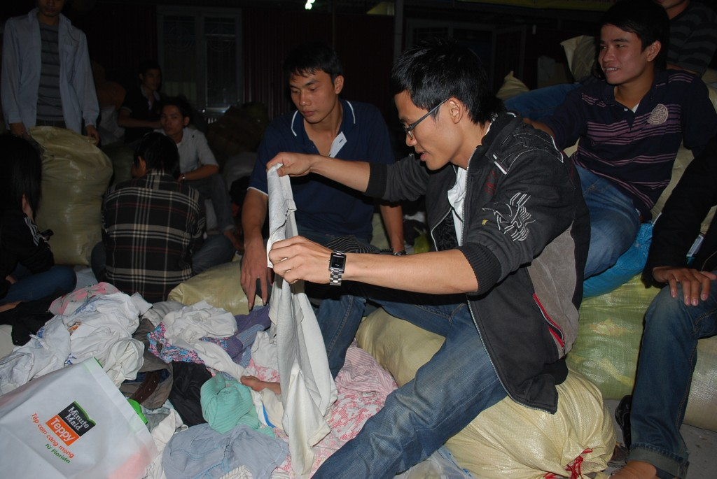 Catholic students in Hanoi packing relief supplies for Vietnamese affected by floods in late 2010 (Photo: Simon Roughneen)