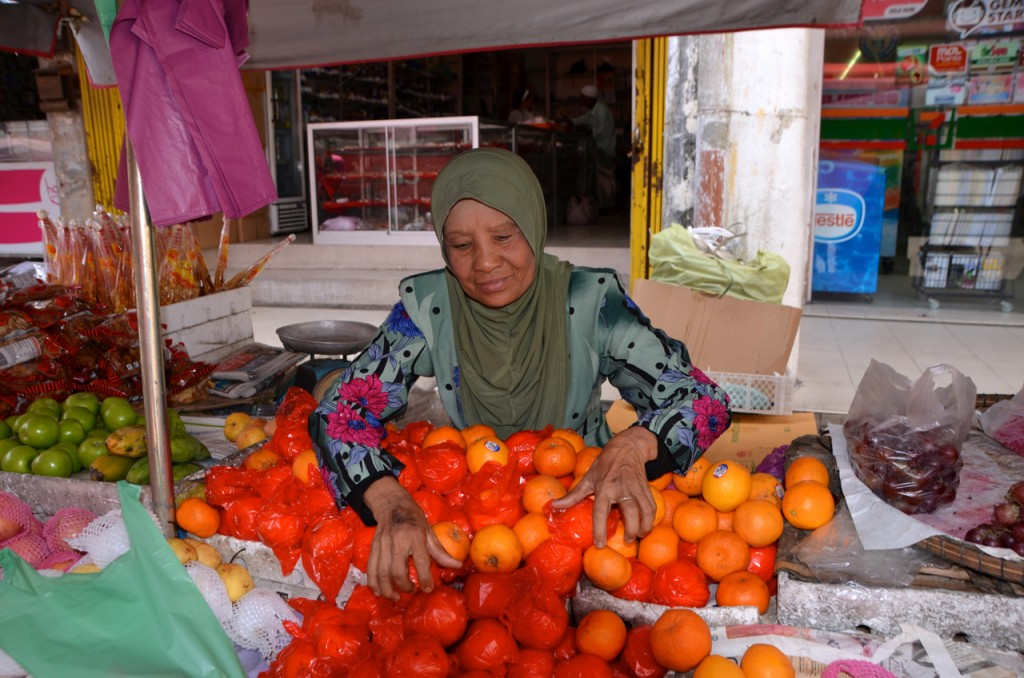 Woman tending to her fruit stall in Kota Bharu (Photo: Simon Roughneen)