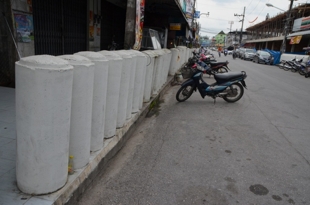 Concrete pillars to protect pedestrians and shopfronts along a Yala sidewalk (Photo: Simon Roughneen)