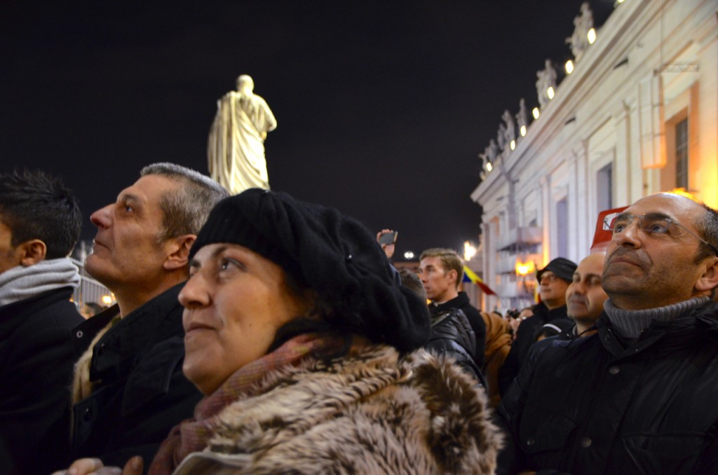 Listening as Pope Francis I is introduced to the world (Photo: Simon Roughneen)