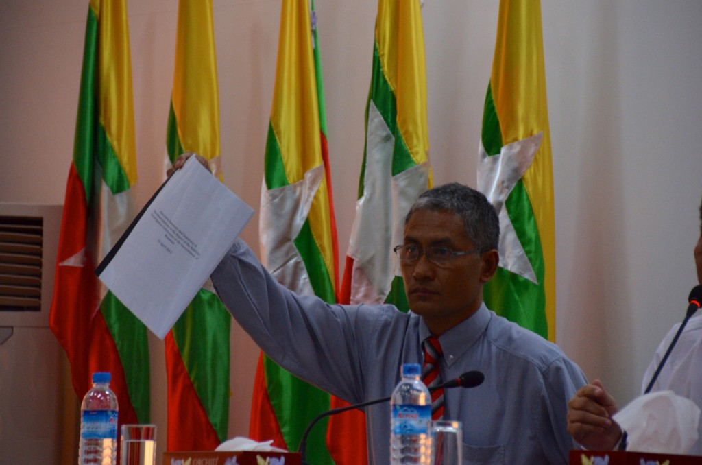 Aung Naing Oo shows off the executive summary of the official Arakan (Rakhine) investigation commission's report (Photo: Simon Roughneen)