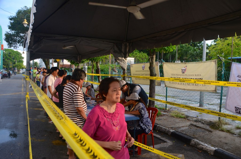 Voters line up early May 5 at Penang polling station (Photo: Simon Roughneen)