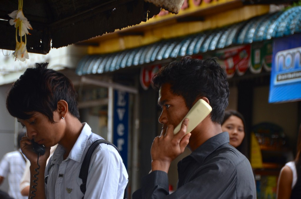 Soon to be history? Landline phones in use outdoors in downtown Rangoon. June 2013. (Photo: Simon Roughneen / The Irrawaddy)