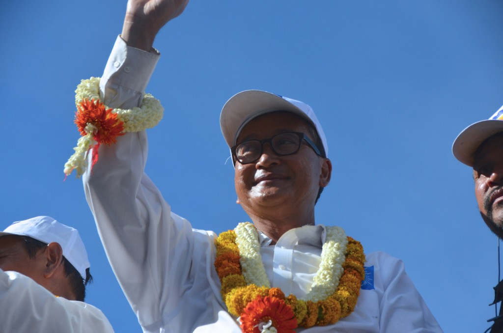 Cambodian opposition leader waves to supporters in Phnom Penh on Friday (Photo: Simon Roughneen)