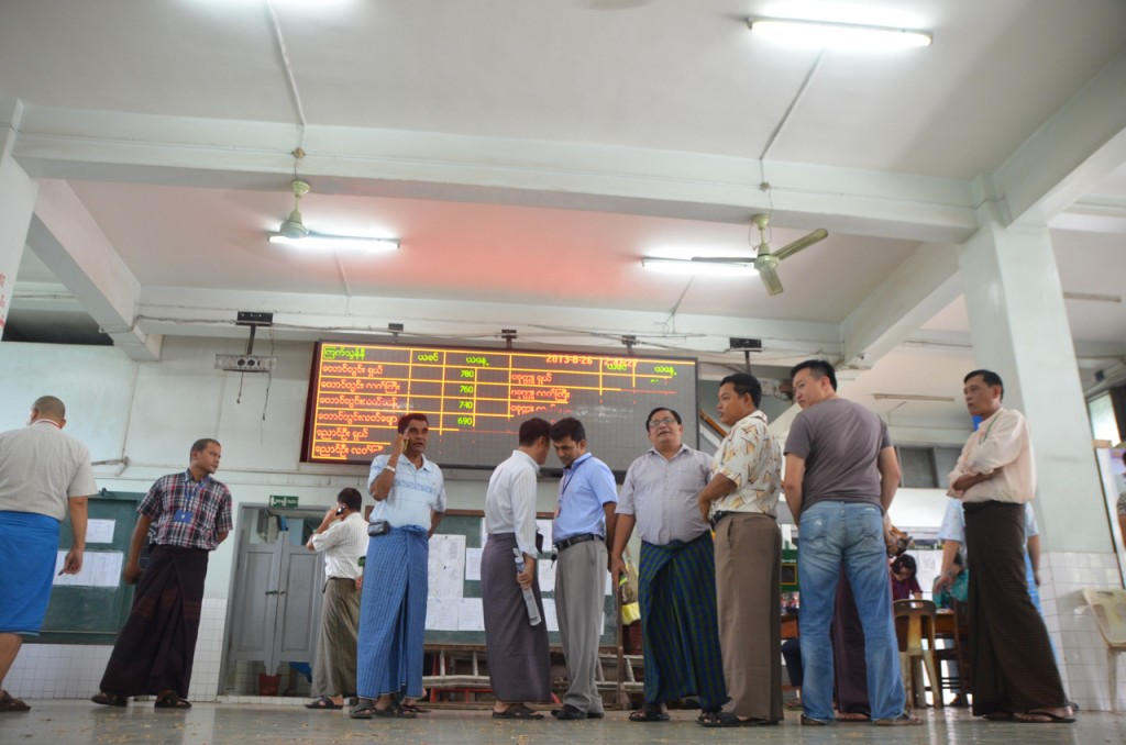 Traders chat after the morning's beans and pulses buying session at Bayintnaung commodities exchange (Photo: Simon Roughneen)