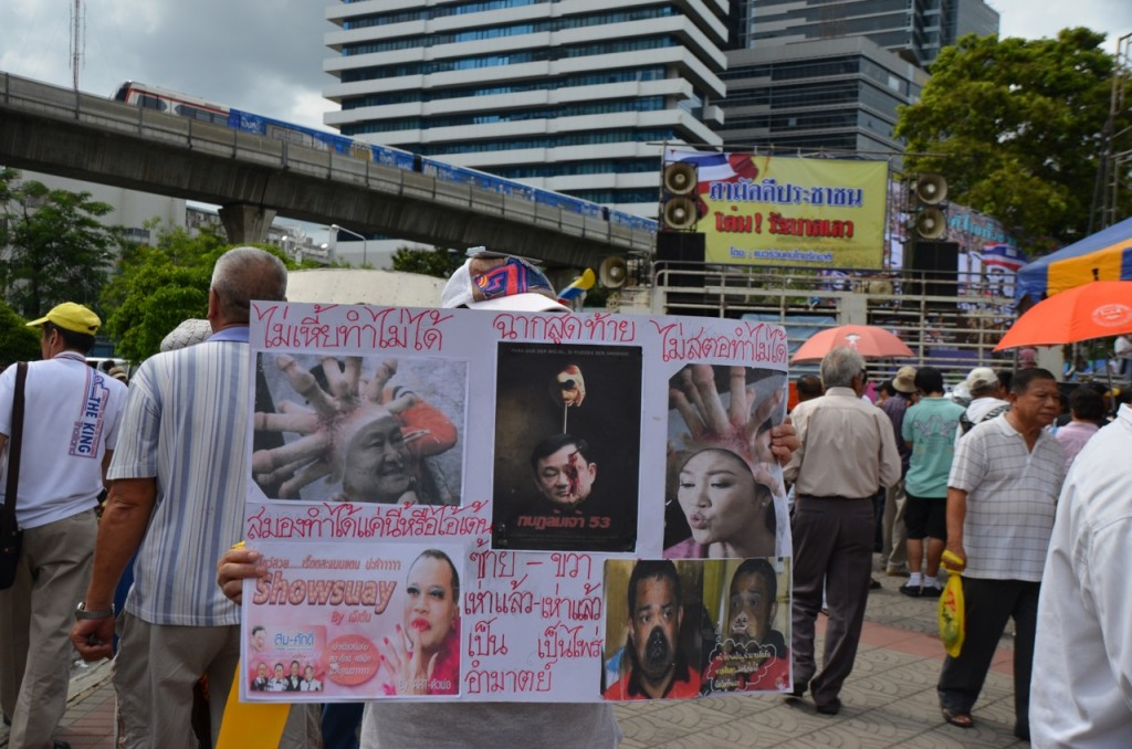 Some lurid commentary about the Shinawatras on display in Bangkok last weekend (Photo: Simon Roughneen)