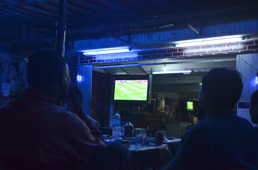 Football gamblers watching opening day of 2013-14 English football season in Tamwe, Rangoon (Photo: Simon Roughneen)
