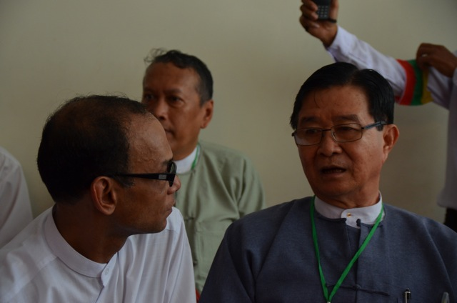 Mya Aye, an 88 Generation leader and Minister Aung Min together at 25th anniversary commemoration of 1988 student uprising in Rangoon on Wednesday (Photo: Simon Roughneen)