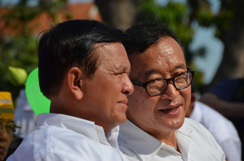 What now? CNRP leaders Kem Sokha and Sam Rainsy confer onstage at the Sept. 7 opposition rally in Phnom Penh (Photo: Simon Roughneen