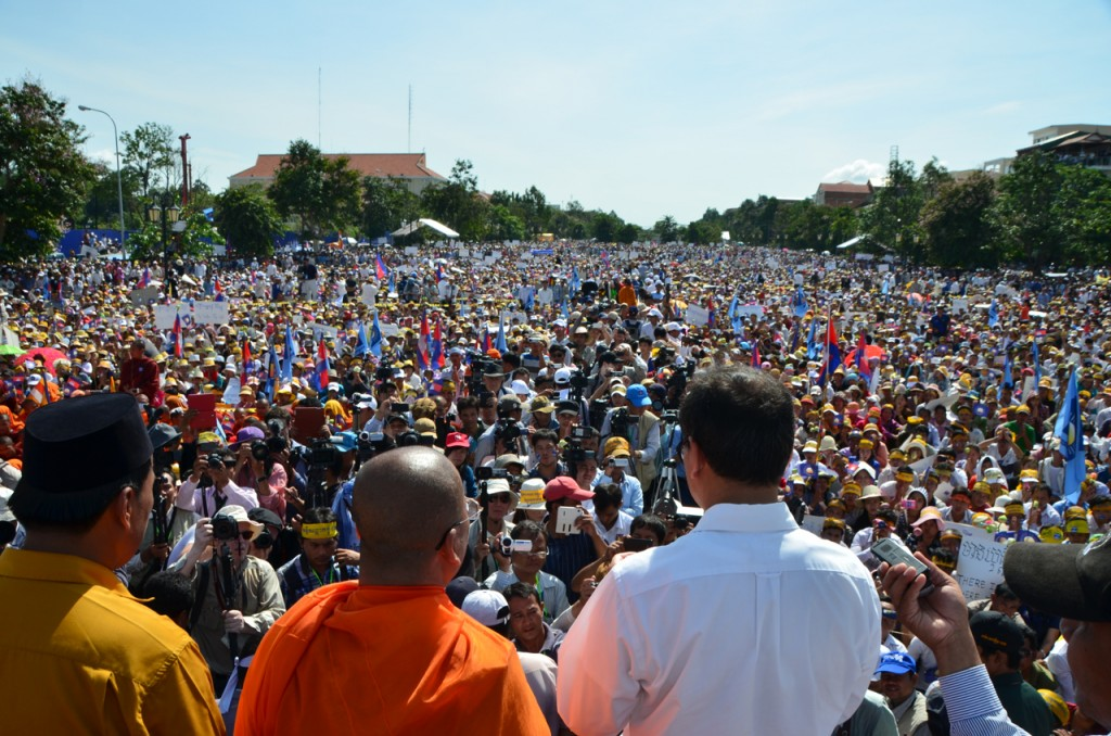 CNRP leader Sam Rainsy addresses an estimated 20,000 crowd in Phnom Penh last Saturday IPhoto: Simon Roughneen)