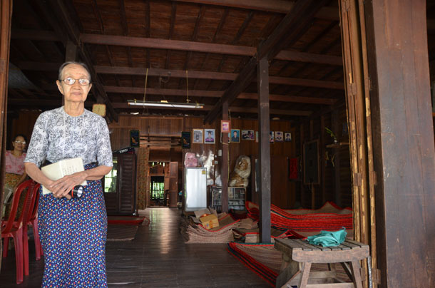 Daw Gyi at the doorway of U Thant's former home in Pantanaw, Irrawaddy Division. (Photo: Simon Roughneen / The Irrawaddy)