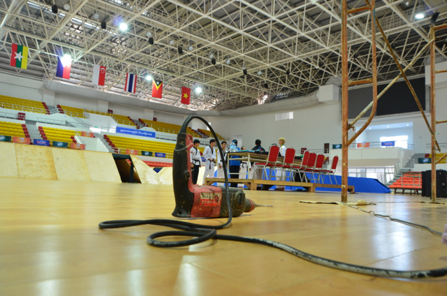 One month away from the start of the Southeast Asian Games, finishing touches are being put on venues, such as this indoor martial arts stadium (Photo: Simon Roughneen / The Irrawaddy)