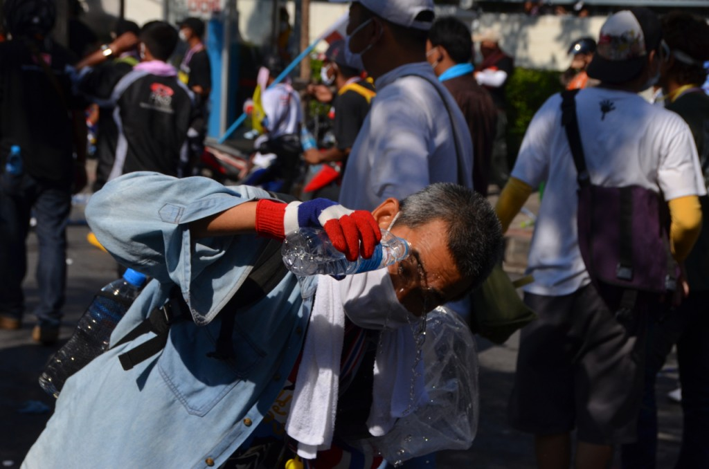 Protestor dealing with effects of tear gas fired by police on Sunday (Photo: Simon Roughneen)