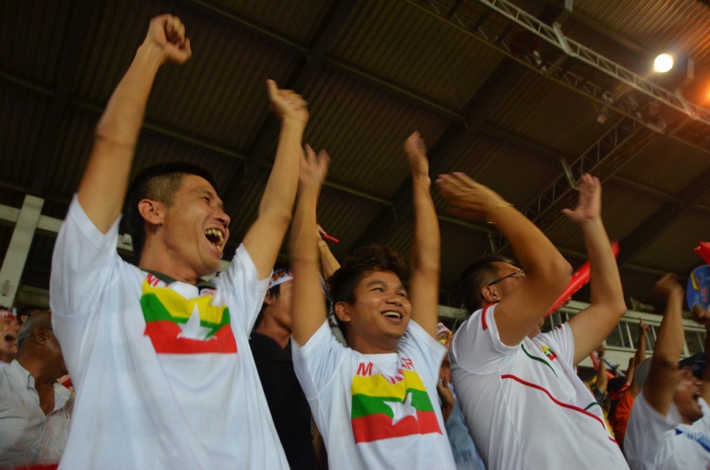 Burmese supporters cheer their team's goal v Thailand on Dec. 15 2013 (Photo - Simon Roughneen)