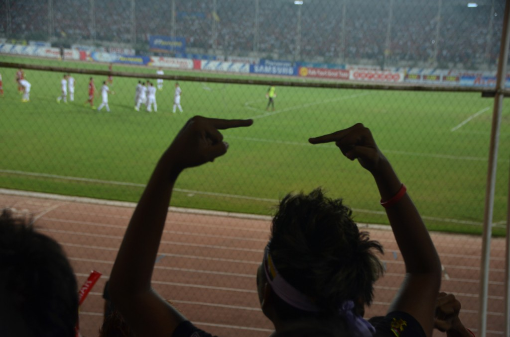 Burmese supporter reacts to shoving match between Thai and Burmese players during Dec 14 draw (Photo: Simon Roughneen)