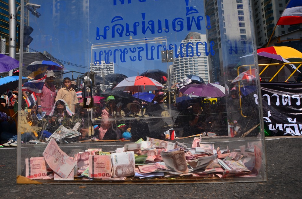 Donation box left between rally stage and protestors gathered at Bangkok's Asoke junction (Photo: Simon Roughneen)