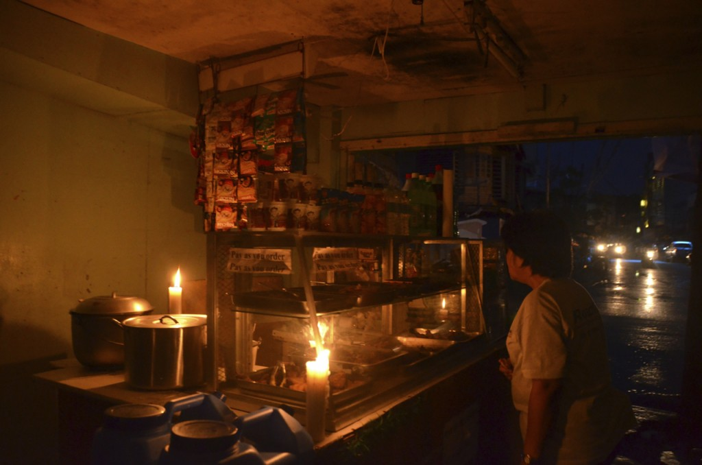 Candlelit shop in downtown Tacloban, where power is not yet fully restored after Typhoon Yolanda (Photo: Simon Roughneen)