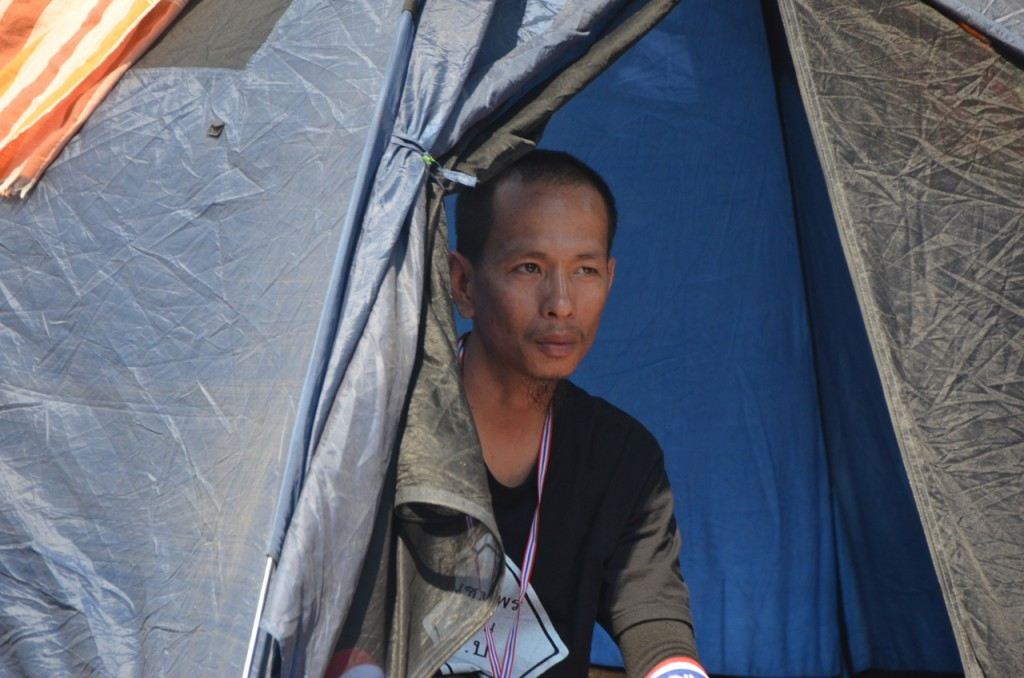 Anti-Government protestor at his tent, pitched under Bangkok's 'Skytrain' line, on Jan 14 (Photo: Simon Roughneen)
