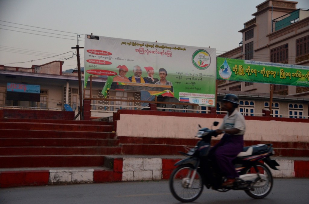 Man rides past billboard promoting Myanmar's census in Taunggyi (Photo: Simon Roughneen)