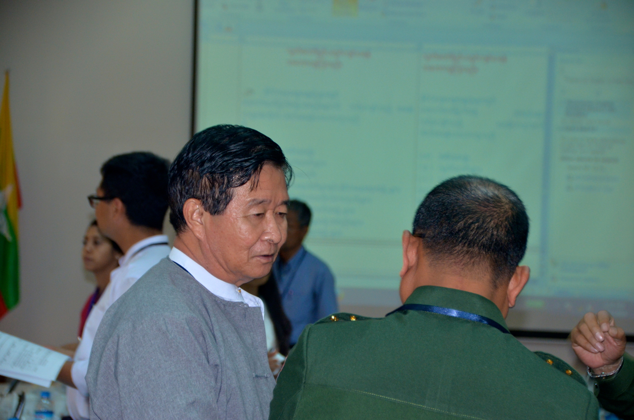 President's Office Minister Aung Min conferring with army delegates at ceasefire talks in Rangoon on Thursday. (Photo: Simon Roughneen