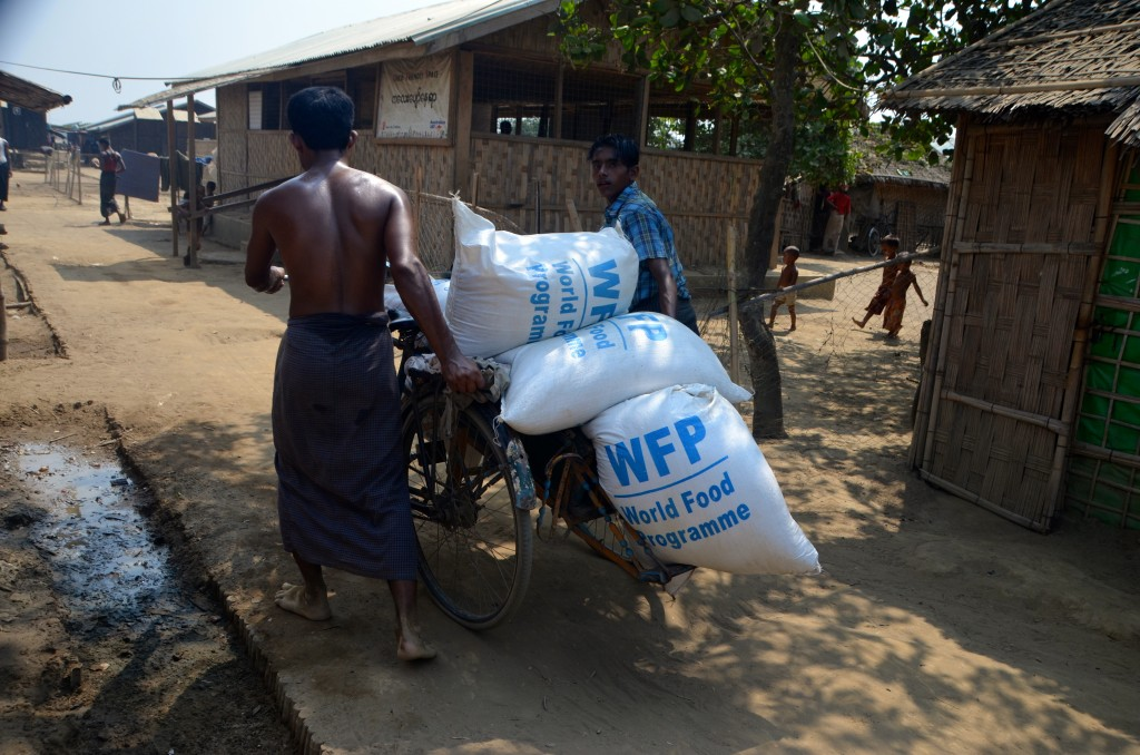 Rohingya carting rice rations inside Dar Paing camp (Photo: Simon Roughneen)