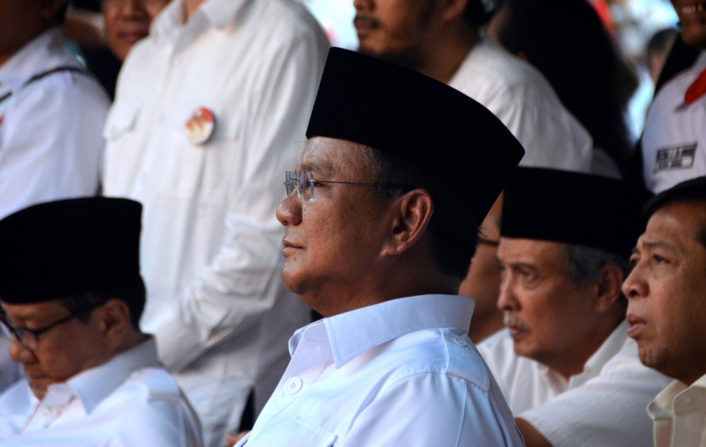 Prabowo Subianto listens to political allies speak at Jakarta's Proclamation Monument  on July 14 (Photo: Simon Roughneen)
