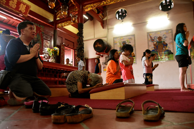 Worshipping inside of one of Georgetown's many Chinese temples (Photo: Simon Roughneen)